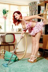 Busty Redhead Doing Housework