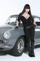 Hitomi posing next to a classic car