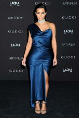 Kim Kardashian in midnight blue at Art + Film Gala...
