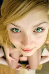 Looking up with her beautiful green eyes while she...