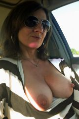 Getting her tits out in the car