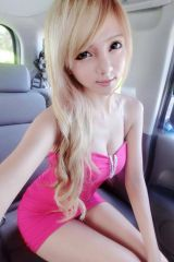 Blonde Asian girl in a pink dress