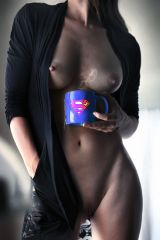 Posing with a Superman coffee mug
