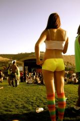 Sexy yellow shorts with knee high rainbow colored ...