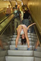 bent over on an escalator