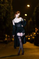 Beautiful redhead in stockings under the streetlig...