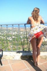 An unexpected breeze reveals her lovely panties