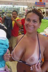 Flashing her tan-lined tits in a retail store