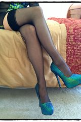Leg crossing action in thigh highs and heels