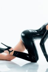Black wetlook catsuit and rubber gloves