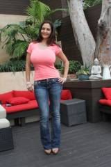 Ava Addams in jeans and a tight pink top