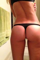 Amateur ass in black thongs