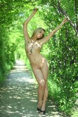 Pretty blonde enjoying the great outdoors nude