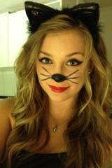 Cat makeup with bright red lipstick
