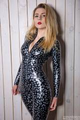 Katerina Piglet in textured latex catsuit by RuBea...