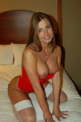 Perfect MILF waiting eagerly in bed
