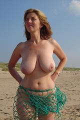 Big breasts at the beach