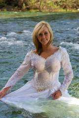 Modeling a brides dress in a river.