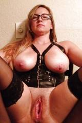 leather corset and glasses