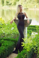 Blonde in a long black evening dress