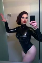 Roswell Ivory selfie showing off her Rubber Eva bo...