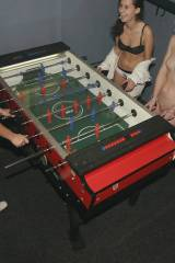 Playing a table soccer game.