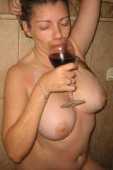 enjoying a glass of wine in the shower