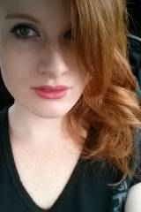 Pink lips, red hair, and pale skin.