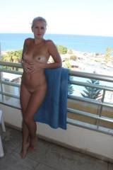 Naked on the balcony