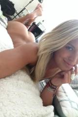 blonde girl lying on bed