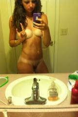 Cute girl in the mirror with tan lines