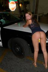 Hot ass flashing on police car [IMG]