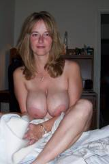 Blue eyed milf with huge boobs
