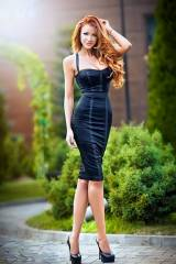 A redhead in a black dress is always a sight to se...