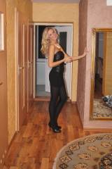 Marta in a black dress and black opaque pantyhose