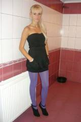 Lilac pantyhose and a black strapless dress