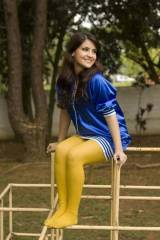 Blue satin dress and yellow pantyhose outside
