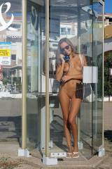 Naked in a phone booth
