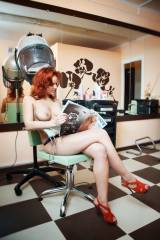 Getting her hair done checking out Playboy