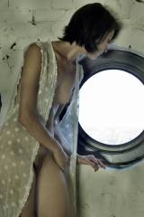 Gazing forlornly out the porthole