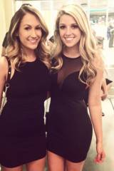 Brunette and blonde in little black dresses