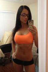 Cute athletic girl with glasses selfie