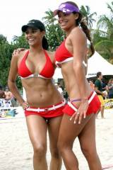 A couple of fine looking beach volleyball players