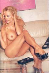 Pamela Anderson by the coffee table