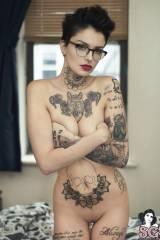 Gorgeous face, slender body and some serious tats