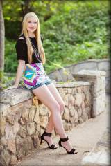 A beautiful blonde wearing my type of skirt!
