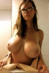 Amateur girl with glasses and some huge boobs