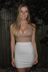 Tight white skirt and a hint of cleavage