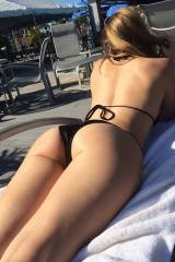 Skye Evans getting some sun by the pool