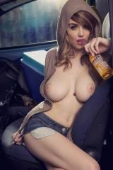 A cutie sipping a Corona with her cans out
